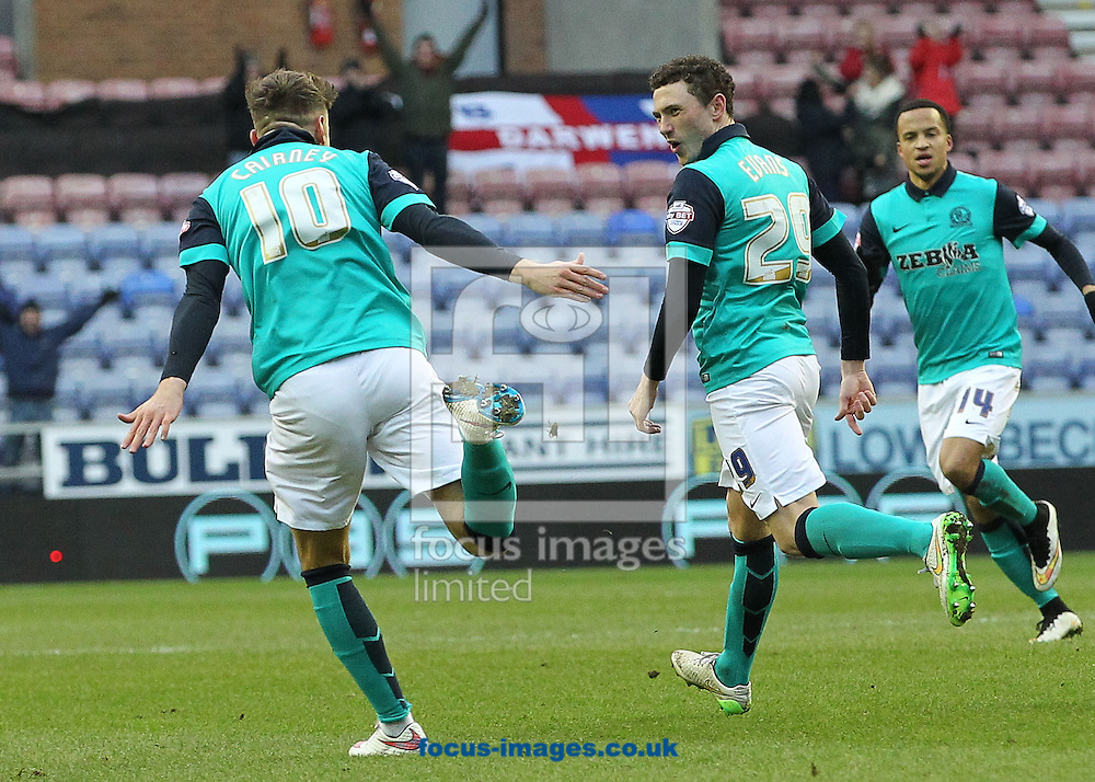 Corry Evans of Blackburn Rovers celebrates with Tom Cairney after scoring the first goal against Wigan Athletic during the Sky Bet Championship match at the DW Stadium, Wigan.<br /> Picture by Michael Sedgwick/Focus Images Ltd +44 7900 363072<br /> 17/01/2015