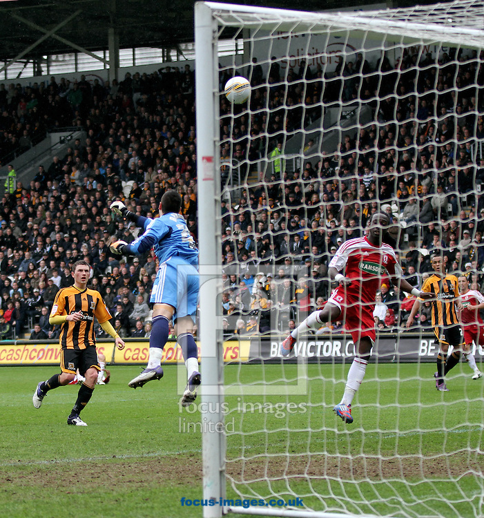 Picture by Richard Gould/Focus Images Ltd. 07710 761829.09/04/12.Vito Mannone of Hull City Saves from Marvin Menes of Middlesbrough during the Npower Championship match at KC Stadium, Hull.