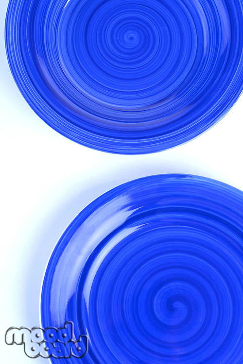 Blue plates on white background