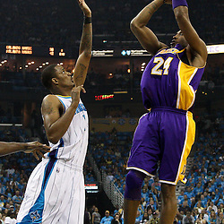 April 28, 2011; New Orleans, LA, USA; Los Angeles Lakers shooting guard Kobe Bryant (24) shoots over New Orleans Hornets small forward Trevor Ariza (1) during the second quarter in game six of the first round of the 2011 NBA playoffs at the New Orleans Arena.    Mandatory Credit: Derick E. Hingle