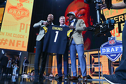 April 26, 2018 - Arlington, TX, U.S. - ARLINGTON, TX - APRIL 26: Terrell Edmunds holds up a jersey and poses for photos with Ryan Shazier and NFL Commissioner Roger Goodell after being chosen by the Pittsburgh Steelers with the 28th pick during the first round at the 2018 NFL Draft at AT&T Statium on April 26, 2018 at AT&T Stadium in Arlington Texas.  (Photo by Rich Graessle/Icon Sportswire) (Credit Image: © Rich Graessle/Icon SMI via ZUMA Press)