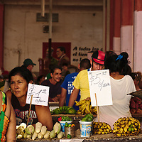 Stands selling fresh produce inside Cienfuegos market