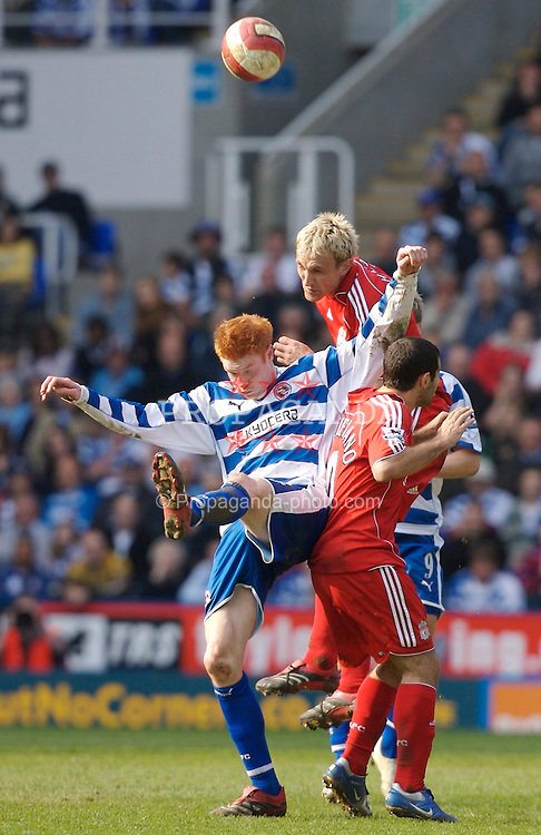 Reading, England - Saturday, April 7, 2007: Liverpool's Sami Hyypia and Javier Mascherano challenge Reading's Dave Kitson during the Premier League match at the Madejski Stadium. (Pic by David Rawcliffe/Propaganda)