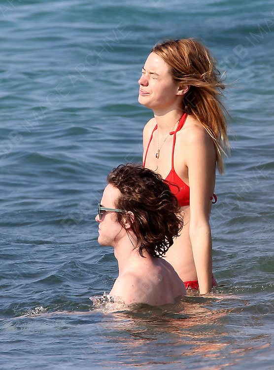 23.JULY.2013. CALVI<br /> <br /> ***NO WEB/NO BLOG/EXCLUSIVE/DO NOT CREDIT***<br /> <br /> CAMILLE ROWE POURCHERESSE AND BOYFRIEND ANDREW VANWYNGARDEN FROM MGMT ON HOLIDAY IN CORSICA. <br /> <br /> BYLINE: EDBIMAGEARCHIVE.CO.UK<br /> <br /> *THIS IMAGE IS STRICTLY FOR UK NEWSPAPERS AND MAGAZINES ONLY*<br /> *FOR WORLD WIDE SALES AND WEB USE PLEASE CONTACT EDBIMAGEARCHIVE - 0208 954 5968*