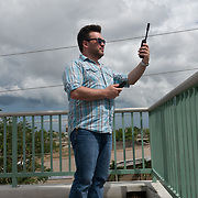 NOVEMBER , 2017&ndash;SAN JUAN, PUERTO RICO&mdash;<br /> NAHJ's Rafael Mejia at the Centro de Periodismo Investigativo tries out a  satellite phone received from NAHJ members  donated in an effort to help local journalists  better cover their communities. <br /> (Photo by Angel Valentin)