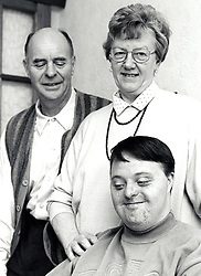 Young man with Down's Syndrome with his parents UK 1995 MR