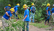 Milby High School senior Karina Sustaita, left, works on a trail at the Houston Arboretum during the Student Conservation Association Houston (SCA) Summer Community Crew Program, July 21, 2014.