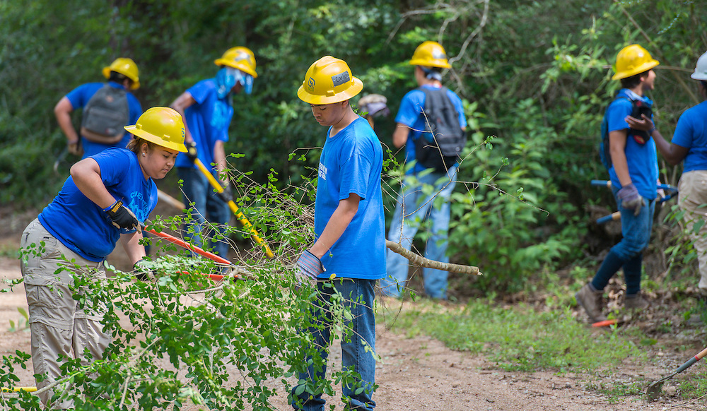 Milby High School senior Karina Sustaita, left, works on a trail at the Houston Arboretum during the Student Conservation Association Houston (SCA) Summer Community Crew Program, July 21, 2014.