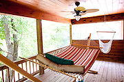 Top selling author Karin Slaughter does all her writing in a cabin in Epworth, Georgia. Her father Howard built the 2,400 square foot cabin for her. An upstairs porch outside of the master bedroom has hammocks and a fan, seen June 13, 2010..CREDIT: Kendrick Brinson/LUCEO.KarinSlaughter