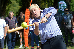 Image ©Licensed to i-Images Picture Agency. 24/07/2014. London, United Kingdom. <br /> <br /> Mayor of London Boris Johnson takes part in a game of softball at Stratford Park, East London, after he announced a £1m investment in his Free Sport Programme for Londoners.<br /> <br /> Picture by Ben Stevens / i-Images