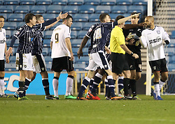 Millwall players argue that they should have a goal kick with Referee Eddie Ilderton- Photo mandatory by-line: Robin White/JMP - Tel: Mobile: 07966 386802 18/01/2014 - SPORT - FOOTBALL - The Den - Millwall - Millwall v Ipswich Town - Sky Bet Championship