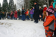 "The small rural community of Yaak Montana gathers to watch the Yaak K-8 grade school sing ""This Land is Your Land"" during the presentation for the cutting of the Capitol Christmas tree at the Historic Upper Ford Ranger Station. Kootenai National Forest in the Purcell Mountains, northwest Montana."