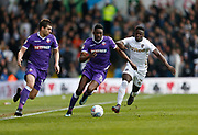 Bolton Wanderers forward Sammy Ameobi is tracked by Leeds United midfielder Ronaldo Vieira during the EFL Sky Bet Championship match between Leeds United and Bolton Wanderers at Elland Road, Leeds, England on 30 March 2018. Picture by Paul Thompson.