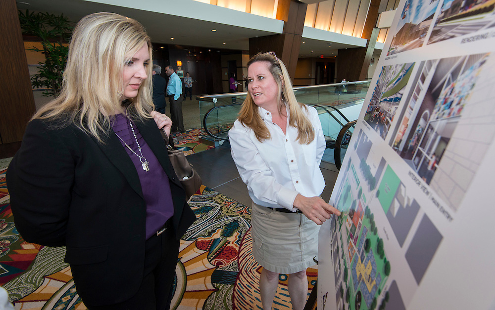 Project Advisory Team (PAT) members discuss the plans for their campus with attendees during the State of the Schools luncheon, February 11, 2015.