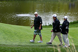 May 15, 2019 - Bethpage, New York, United States - John Daly (L) walks the 8th green during a practice round at the 101st PGA Championship at Bethpage Black. (Credit Image: © Debby Wong/ZUMA Wire)