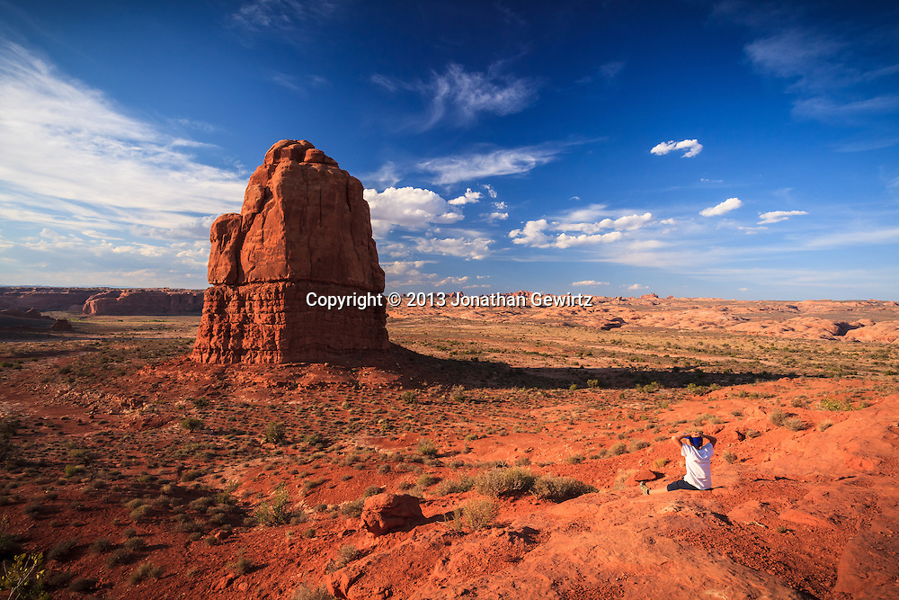 A young visitor takes in the dramatic rock formations of Arches National Park, Utah. WATERMARKS WILL NOT APPEAR ON PRINTS OR LICENSED IMAGES.<br />