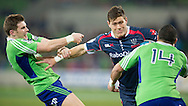 Rory Sidey (Rebels) is tackled by Colin Slade (Highlanders) and Kade Poki (Highlanders) during the Round 17 match of the 2013 Super Rugby Championship between RaboDirect Rebels vs Highlanders at AAMI Park, Melbourne, Victoria, Australia. 12/07/0213. Photo By Lucas Wroe
