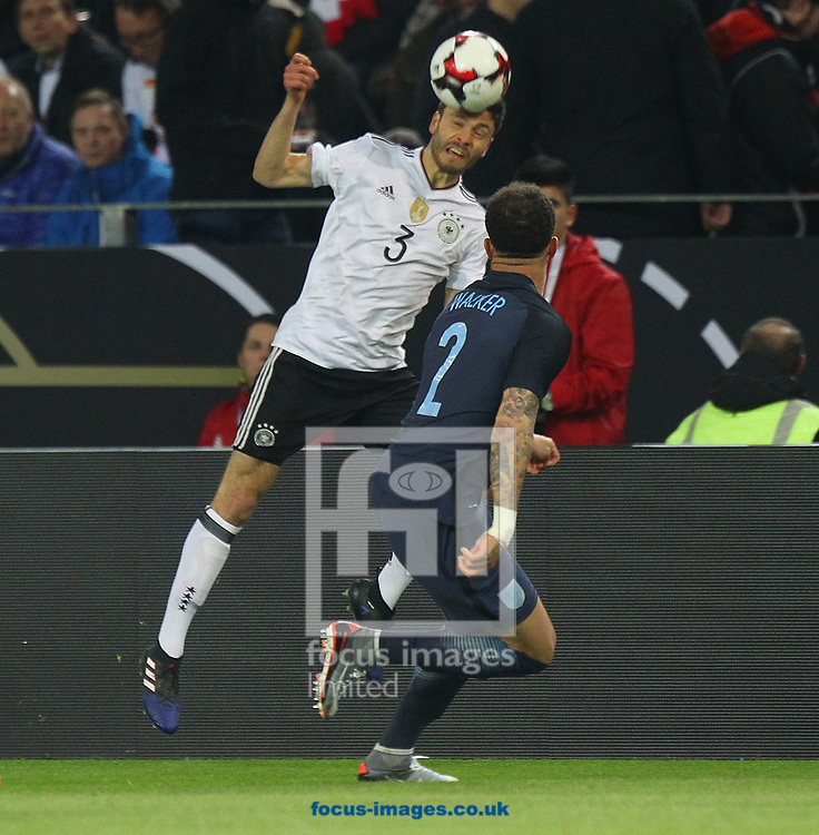Jonas Hector of Germany and Kyle Walker of England in action during the International Friendly match at Signal Iduna Park, Dortmund<br /> Picture by Paul Chesterton/Focus Images Ltd +44 7904 640267<br /> 22/03/2017
