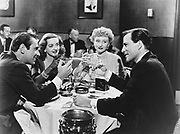 ALL ABOUT EVE, Fox, 1950. Producer: Darryl F. Zanuck. Director: Joseph L. Mankiewicz. Starring Bette Davis. Left to right: Garry Merrill, Bette Davis as Carol Channing, Celeste Holm, Hugh Marlow