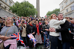 UK ENGLAND LONDON 29APR11 - A couple hugs amongst crowds of onlookers awaiting TRH Prince William, Duke of Cambridge and Catherine, Duchess of Cambridge going past the Mall following their marriage at Westminster Abbey on April 29, 2011 in London, England.  The event has been watched on TV by an estimated two billion people.....jre/Photo by Jiri Rezac....© Jiri Rezac 2011