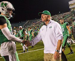 Oct 9, 2015; Huntington, WV, USA; Marshall Thundering Herd head coach Doc Holliday celebrates beating Southern Miss Golden Eagles at the end of the game at Joan C. Edwards Stadium. Marshall won the game 31-10. Mandatory Credit: Ben Queen-USA TODAY Sports