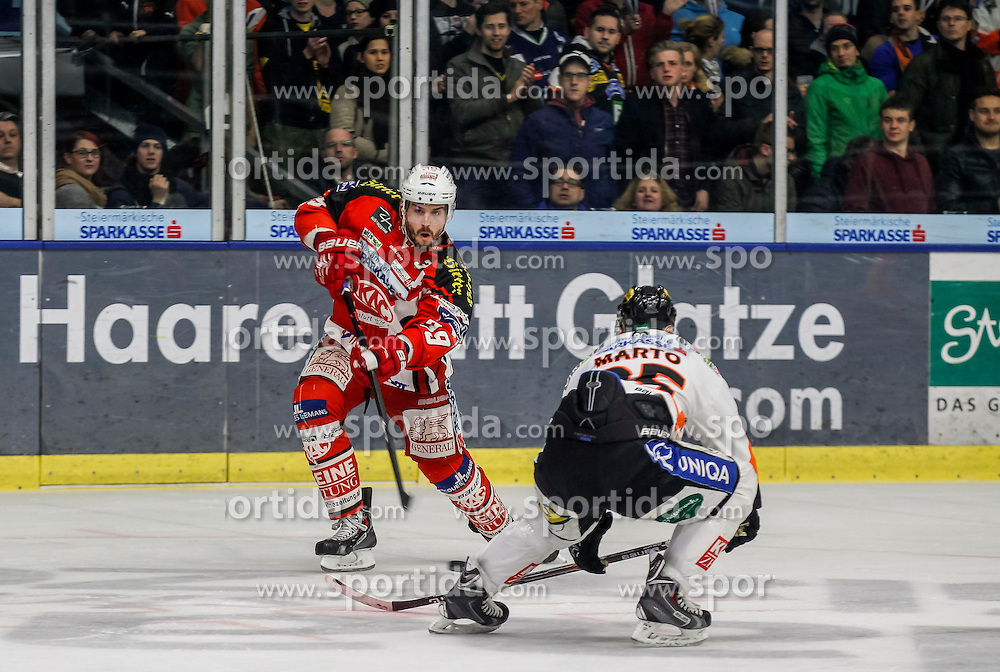 27.02.2015, Eisstadion Liebenau, Graz, AUT, EBEL, Moser Medical Graz 99ers vs EC KAC, 52. Runde, im Bild Jean-Francois Jacques (EC KAC) und Jake Marto (Moser Medical Graz 99ers) // Jean-Francois Jacques (EC KAC) and Jake Marto (Moser Medical Graz 99ers) during the Erste Bank Icehockey League 52nd Round match between Moser Medical Graz 99ers and EC KAC at the Ice Stadium Liebenau, Graz, Austria on 2015/02/27, EXPA Pictures © 2015, PhotoCredit: EXPA/ Erwin Scheriau
