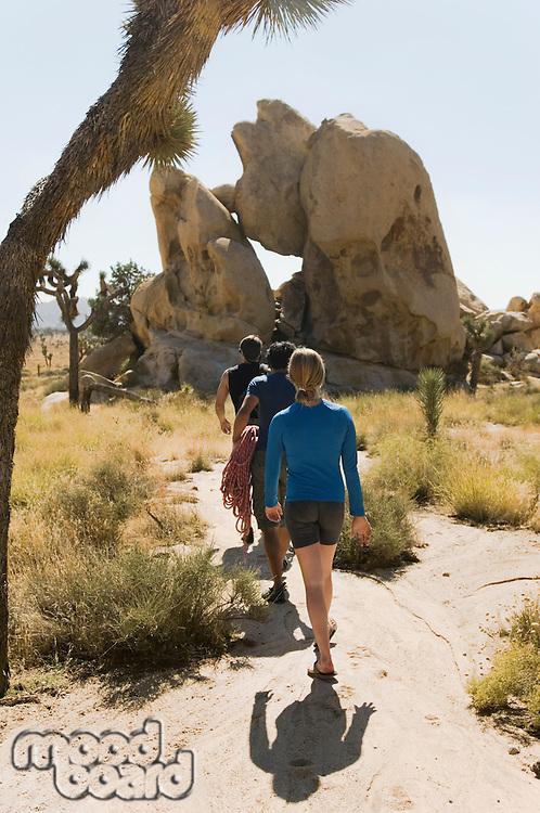 Climbers Walking Through Desert
