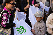 A woman and her son show a t-shirt with the Ideas City logo that has just been silkscreened for them by Works in Progress NYC.