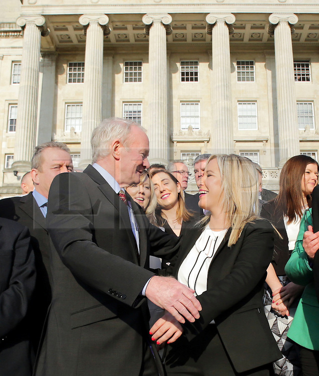 © Licensed to London News Pictures. STORMONT BELFAST - 23 JAN 2017: Sinn Fein's Michelle O'Neill gets a hug from Martin McGuinness, on the steps of Stormont after being named as the new leader of Sinn Fein in the North, taking over from former deputy first minister Martin McGuinness who has retired due to illness. Photo credit: London News Pictures.