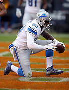 Detroit Lions tight end Timothy Wright (83) is celebrates after catching a 9 yard touchdown pass for a 7-0 first quarter Lions lead during the NFL week 17 regular season football game against the Chicago Bears on Sunday, Jan. 3, 2016 in Chicago. The Lions won the game 24-20. (©Paul Anthony Spinelli)