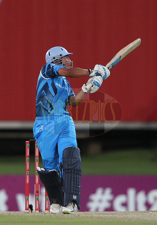 Henry Davids of the Titans hooks a delivery to the boundary during the 2nd semi final of the Karbonn Smart CLT20 South Africa between The Sydney SIxers and the The Titans held at Supersport Park in Centurion, Gauteng on the 26th October 2012..Photo by Shaun Roy/SPORTZPICS/CLT20.