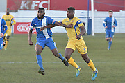 Scarborough Athletic, Benny Igiehon (9) ansd Glossop North End  Mohamud Ali (3)  during the Evo-Stik Premier League match between Glossop North End and Scarborough Athletic at the Arthur Goldthorpe Stadium, Glossop, United Kingdom on 26 November 2016. Photo by Mark Pollitt.