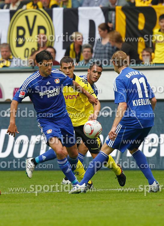 22.08.2010, Signal Iduna Park, GER, Hinrunde 2010/2011, Borussia Dortmund vs Bayer 04 Leverkusen, im Bild: Michael Ballack (#13 Bayer 04 Leverkusen), dahinter Sebastian Kehl (Dortmund GER #5), rechts Stefan Kieflling (Bayer 04 Leverkusen GER #11), EXPA Pictures © 2010, PhotoCredit: EXPA/ nph/  Scholz+++++ ATTENTION - OUT OF GER +++++ / SPORTIDA PHOTO AGENCY