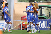 Colchester Utd forward Denny Johnstone celebrates with team mates and the club mascot after scoring the second goal during the EFL Sky Bet League 2 match between Colchester United and Cambridge United at the Weston Homes Community Stadium, Colchester, England on 13 August 2016. Photo by Nigel Cole.