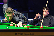 Jack Lisowski looks on as Mark Selby takes his opportunity to get back on terms in the early exchanges of the World Snooker 19.com Scottish Open Final Mark Selby vs Jack Lisowski at the Emirates Arena, Glasgow, Scotland on 15 December 2019.