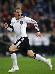BASTIAN SCHWEINSTEIGER.GERMANY.GERMANY V IVORY COAST.VELTINS ARENA, GELSENKIRCHEN, GERMANY.18 November 2009.GAB4641..  .WARNING! This Photograph May Only Be Used For Newspaper And/Or Magazine Editorial Purposes..May Not Be Used For, Internet/Online Usage Nor For Publications Involving 1 player, 1 Club Or 1 Competition,.Without Written Authorisation From Football DataCo Ltd..For Any Queries, Please Contact Football DataCo Ltd on +44 (0) 207 864 9121