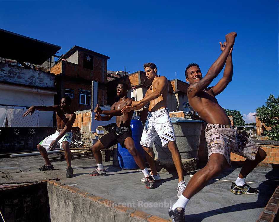 "Vitor Hugo, Diego, Anderson and Heverton, ""Muleks 100 limits"" (""boys without limits"") are training on the rooftop of Diego's house, on the heights of  Mangueira slum. They rehearse almost every day, and perfect their choreographies, hoping to have success on the carioca funk scene and get a better life. Mangueira, Rio de Janeiro.."