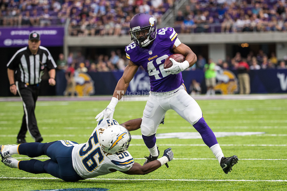 Aug 28, 2016; Minneapolis, MN, USA; Minnesota Vikings running back Jhurell Pressley (42) breaks a tackle from San Diego Chargers linebacker Shaq Petteway (56) during a preseason game at U.S. Bank Stadium. The Vikings defeated the Chargers 23-10. Mandatory Credit: Brace Hemmelgarn-USA TODAY Sports