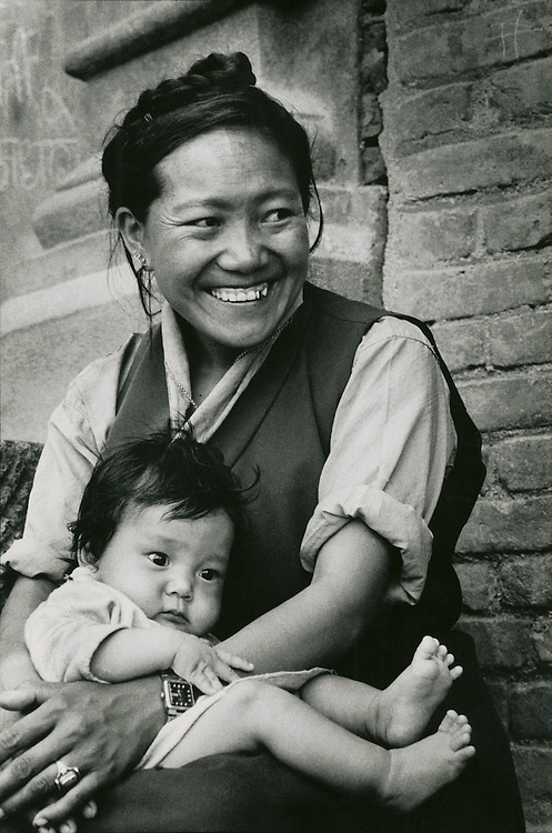 A woman and child in Kimtole village near the Buddhist shrine of Swyambhunath in Nepal's Kathmandu Valley. The woman wears Tibetan style clothing.