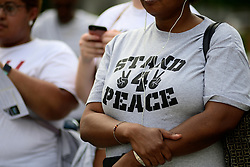A handful listen to the speakers at the Stand 4 Peace anti gun-violence rally in Love park, on Tuesday, The event was held in reaction to the mass-shooting that killed one and injured six at graduation party in South Philadelphia, on Father's Day.
