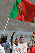 Portuguese players Nani and Cristiano Ronaldo celebrating with supporters at Alameda Dom Afonso Henriques, in Lisbon. Portugal's national squad won the Euro Cup the day before, beating in the final France, the organizing country of the European Football Championship, in a match that ended 1-0 after extra-time.