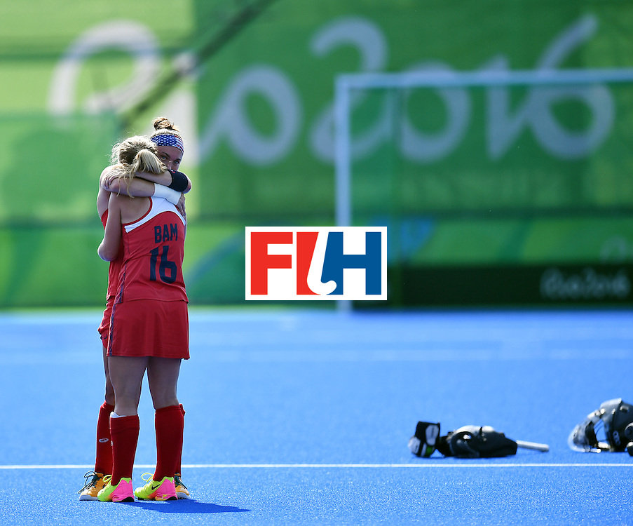 The USA's Katie Bam and Michelle Kasold hug each other at the end of the the women's quarterfinal field hockey USA vs Germany match of the Rio 2016 Olympics Games at the Olympic Hockey Centre in Rio de Janeiro on August 15, 2016. / AFP / MANAN VATSYAYANA        (Photo credit should read MANAN VATSYAYANA/AFP/Getty Images)