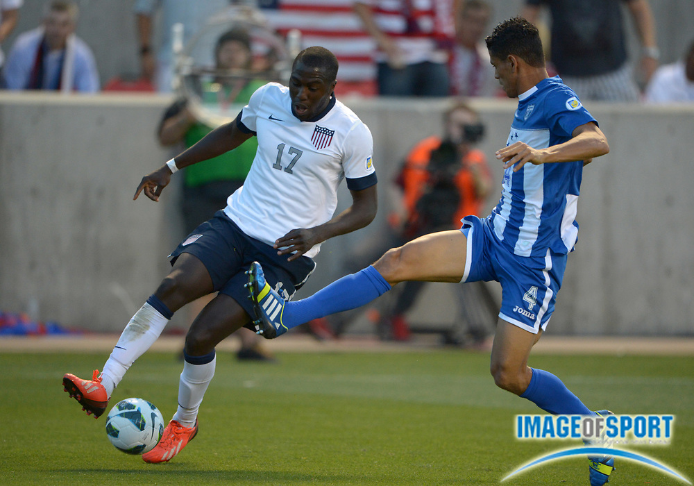 Jun 18, 2013; Sandy, UT, USA; United States forward Jozy Altidore (17) and Honduras defender Juan Pablo Montes (4) battle for the ball in a FIFA World Cup Qualifier at Rio Tinto Stadium.