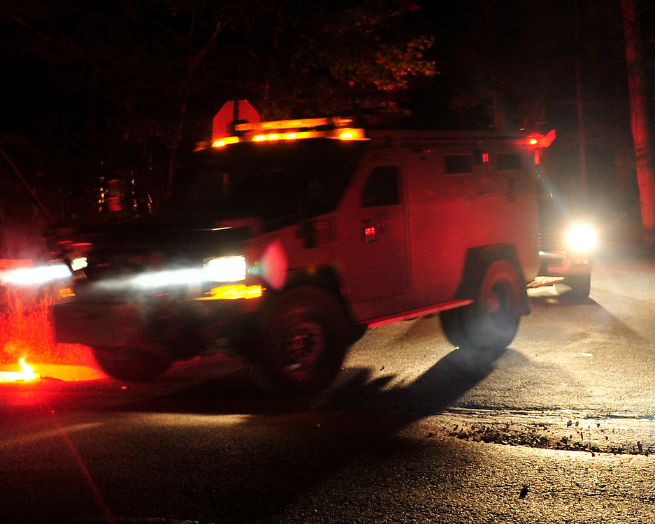 Police surround a neighborhood in the Pocono Mountains in search  of ambush suspect Eric Matthew Frein who is accused of shooting two Pennsylvania State Troopers Sept. 20th, 2014 in Canadensis, Pennsylvania. (Chris Post | lehighvalleylive.com)