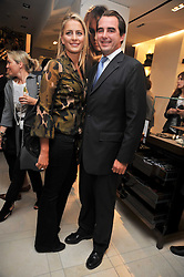 PRINCE NICKOLAS OF GREECE and close friend TATIANNA BLACKNICK at a reception hosted by Vogue and Burberry to celebrate the launch of Fashions Night Out - held at Burberry, 21-23 Bond Street, London on 10th September 2009.