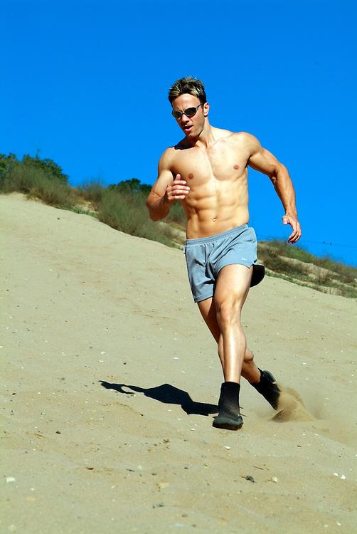 Man runs dunes in Los Angeles, CA.