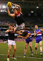 Jeremy Howe of the Demons takes a screamer high over Jack Trengove and Liam Picken of the Bulldogs during the round 23 AFL match between the Western Bulldogs and the Melbourne Demons at Etihad Stadium on September 1, 2013. (Copyright Michael Dodge/Getty Images)