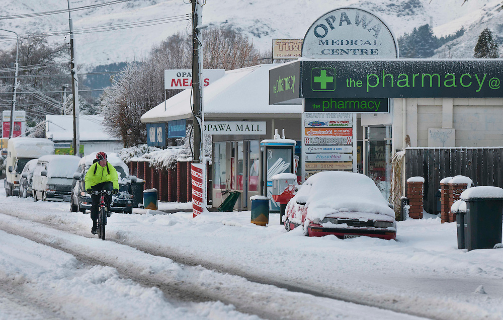 A cyclist navigates slippery conditions in Opawa, Christchurch, New Zealand, Tuesday, August 16, 2011. Credit: SNPA / David Alexander