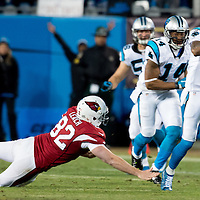 Carolina Panthers wide receiver Ted Ginn (19) breaks the tackle of Arizona Cardinals long snapper Mike Leach (82).