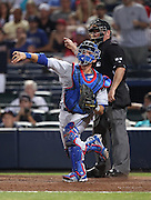 ATLANTA, GA - JUNE 08:  Catcher JP Arencibia #9 of the Toronto Blue Jays makes a throwing error to allow the Atlanta Braves to score the winning run and end the game at Turner Field on June 8, 2012 in Atlanta, Georgia.  (Photo by Mike Zarrilli/Getty Images)